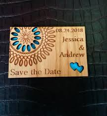 wood save the date magnet engraved flower save the date