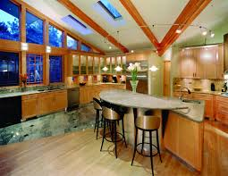 Track Lighting For Kitchen Island by Captivating Wooden Floor And Luxury Semicircle Cabinetry With