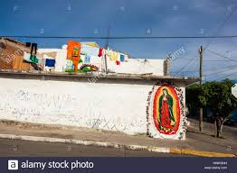 the virgin of guadalupe mural painted on a wall in the mexican stock photo the virgin of guadalupe mural painted on a wall in the mexican city of mazatlan in sinaloa state