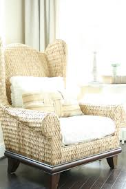this wicker wingback chair would be on a patio or indoor