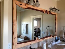 wood framed large bathroom mirror above double sink bathroom