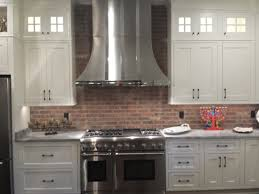 interior farmhouse kitchen with brick backsplash and copper