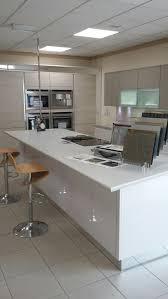 by design geneva gloss cashmere and anthracite kitchen with corian