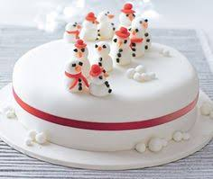 Christmas Cake Decorations Recipes by Iced Cake With Iceberg Detailing And Black And White Penguins