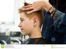 young boy with red hair getting a haircut stock image image