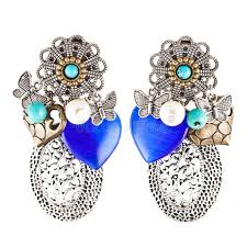 home made earrings earrings with blue heart shaped stones stock image