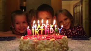 birthday cake with the words happy birthday candles burning stock