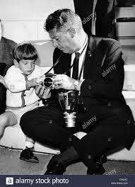 john f kennedy jr takes an interest in the cameras of white