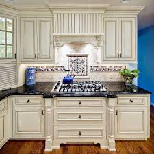 captivating cream kitchen cabinets with black countertops