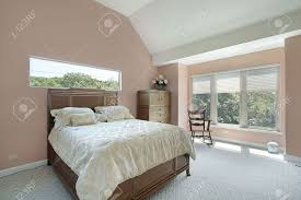 master bedroom in suburban home with mauve colored walls stock