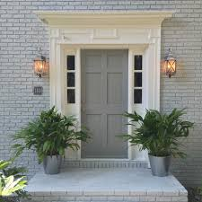 exterior grey brick house houston with white classic trim and