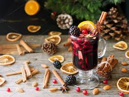New Year Food Decoration glass of mulled wine for the new year with ingredients for