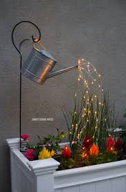 glowing watering can with fairy lights how neat is this it u0027s so