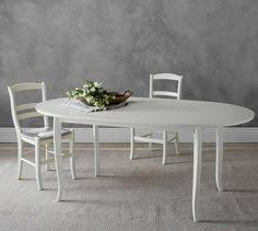 Extending Kitchen Tables by A Simplified Silhouette In Artisanal White Makes This Table The