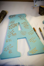 have guests write their well wishes on large wooden initials what