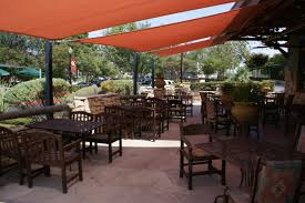 exterior orange patio sail sun shades overed on brown wooden