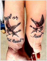 bird tattoo designs for couples on arm couples matching tattoos