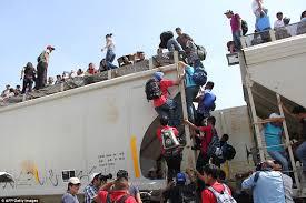 la bestia central americans pictured climbing aboard la bestia for