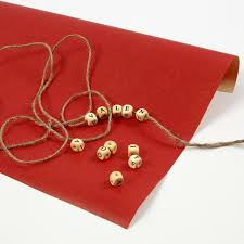 gift wrapping with wooden beads with letters on natural twine