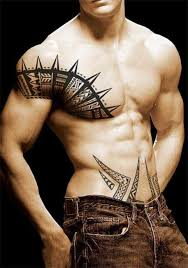 chest and shoulder tribal tattoos