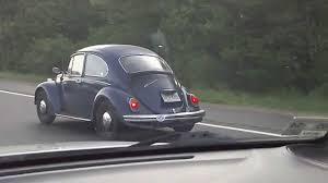 blue volkswagen beetle vintage blue vintage vw beetle bug volkswagon car on highway youtube