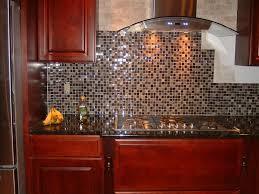 dark glass and stone tile backsplash cabinet hardware room