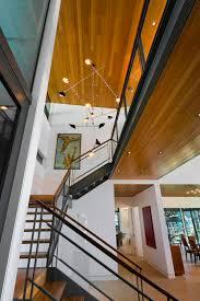 floating type staircase wood ceiling with gunmetal steel beams