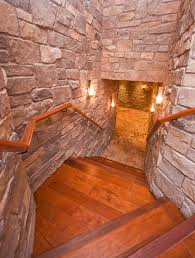 Mediterranean Wall Sconces Basement Den Staircase Mediterranean With Brick Floor Incandescent