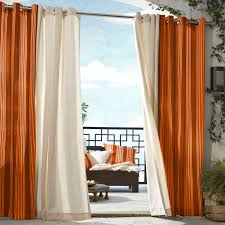 white and orange window curtains with steel rod on white wall of
