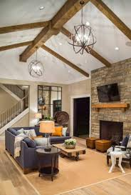 contemporary rustic family room with stone fireplace and vaulted