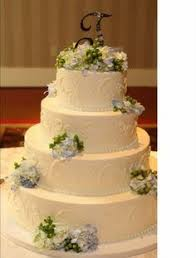 four tier buttercream wedding cake with fresh flowers cake and