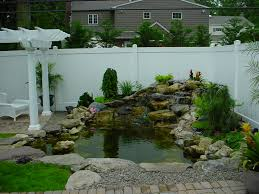 Wall Garden Kits by Surprising Small Garden With Pond With White Wall U2013 Radioritas Com