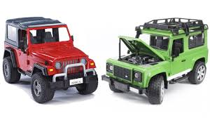 jeep toy car bruder two off road vehicles land rover and jeep wrangler