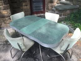 green formica and chrome retro kitchen table and chairs