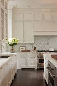 Kitchen With Wood Floors by What We U0027re Loving Now Shiplap Walls Black Countertops White