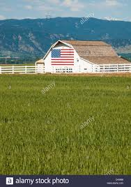 How To Paint American Flag White Barn With Painted American Flag In Colorado Stock Photo