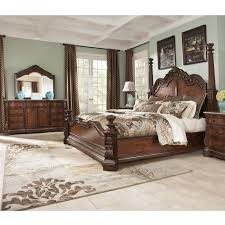 Antique Finish Bedroom Furniture Go Grand In Your Master Bedroom This Traditional Bedroom Set From