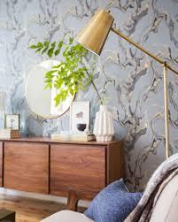 a neutral mid century living room vignette emily henderson