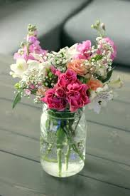 jar flower arrangement simple diy jar centerpiece ideal for a rustic wedding