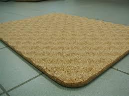 bathroom fancy pvc brown bath mats on gray ceramic tile flooring