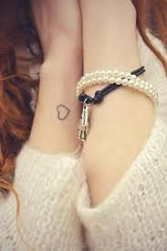 small and simple heart outline on girls wrist tattoo love
