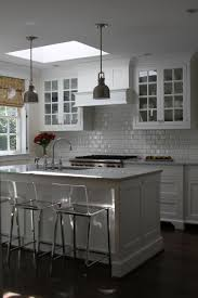 Designer Fitted Kitchens by White Wooden Kitchen Island With Brown Wooden Counter Top Plus