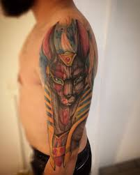 watercolor anubis tattoo on man left half sleeve