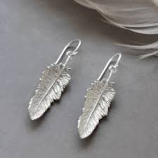 silver feather earrings sterling silver small feather drop earrings by martha jackson
