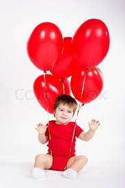 valentines baby baby boy with balloons valentines day stock photo