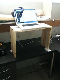 diy standing desk converter quick and free ways to convert an existing desk into a standing desk