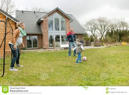 family playing soccer in the garden stock photo image 57530048