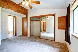Empty White Bedroom White Empty Bedroom With Mirror Door Closet Blade Ceiling Fan