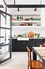 kitchen matt black cabinets white farmhouse sink zinc benchtop