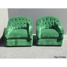 vintage pair of mid century modern tufted green velvet swivel club